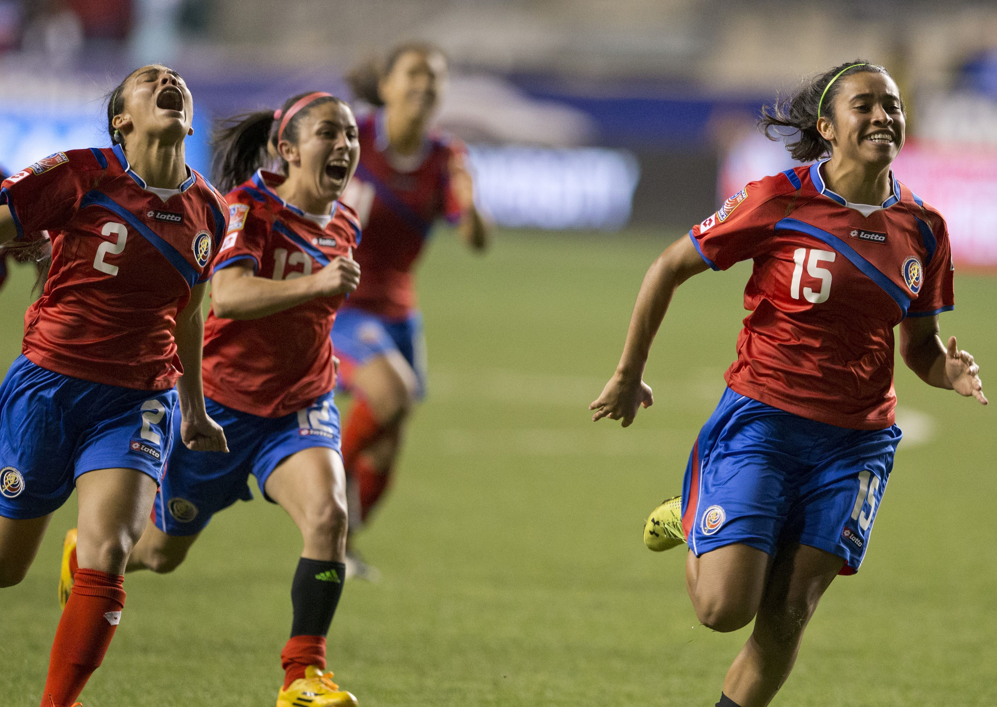 CHESTER, PA - OCTOBER 24: Lixy Rodriguez #12, Gabriela Guillen #2, Cristin Granados #15 of Costa Rica react after defeating Trinidad & Tobago in a shoot out in the  2014 CONCACAF Women's Championship semifinal game on October 24, 2014 at PPL Park in Chester, Pennsylvania. (Photo by Mitchell Leff/Getty Images)  Costa Rica defeated Trinidad & Tobago in a shoot out 3-0