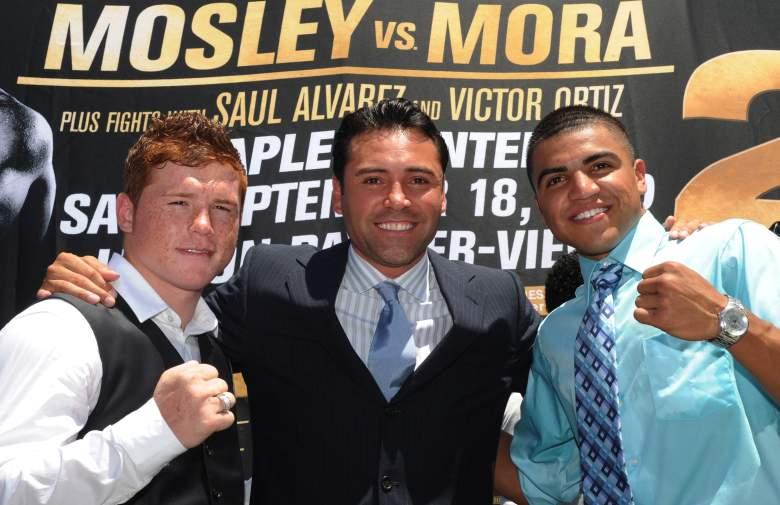 Canelo Álvarez (izq. a der.), Oscar de la Hoya y Victor Ortiz (Getty)