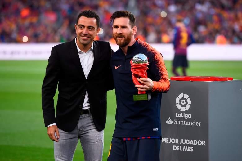 Xavi Hernandez y Lionel Messi